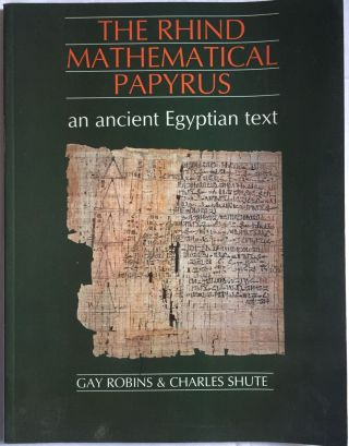 The Rhind mathematical papyrus. An ancient Egyptian text. ROBINS Gay - SHUTE Charles[newline]M4364.jpg